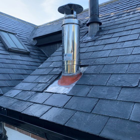 stainless steel flue fitted to roof